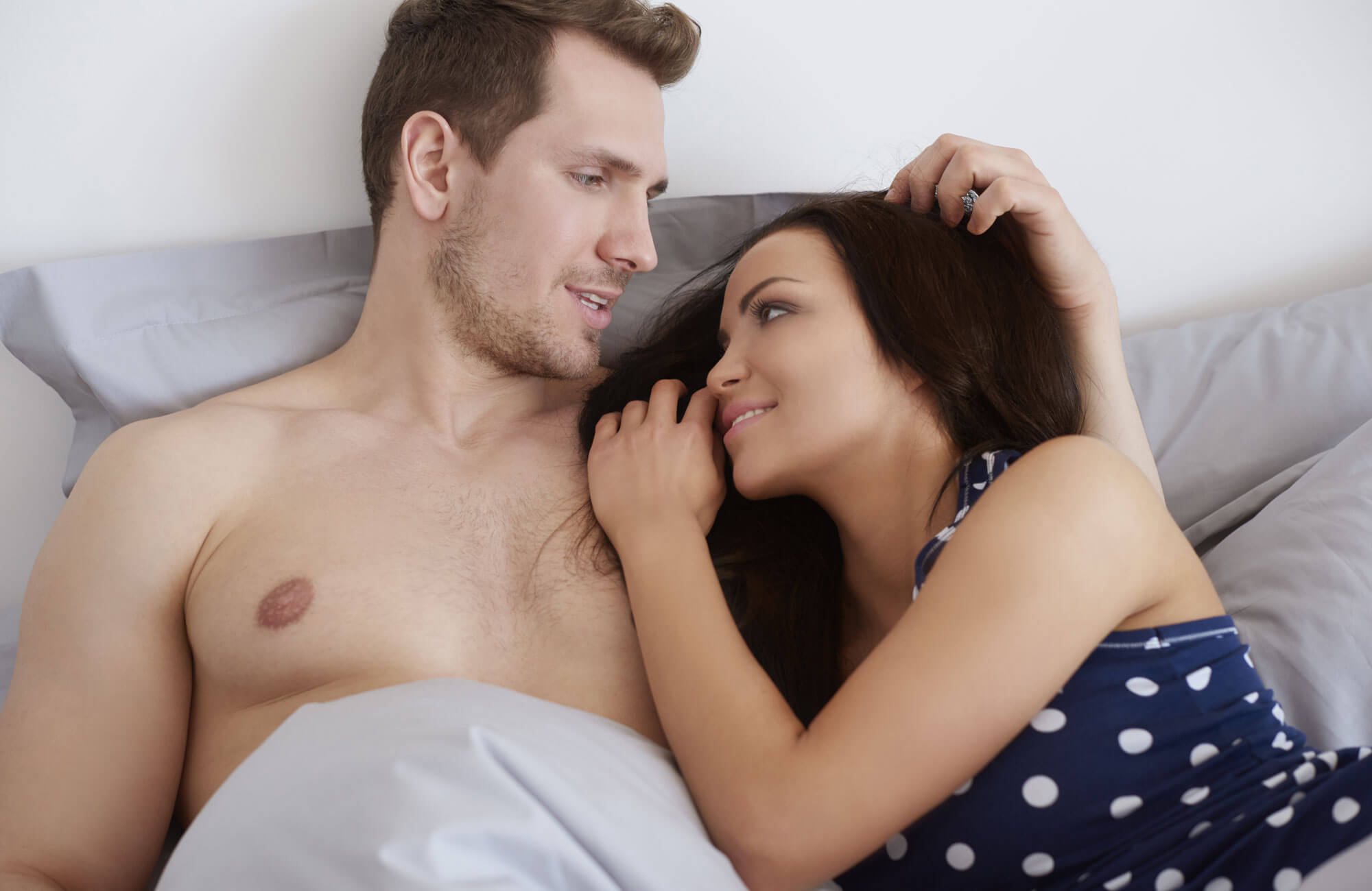 girl and guy on bed